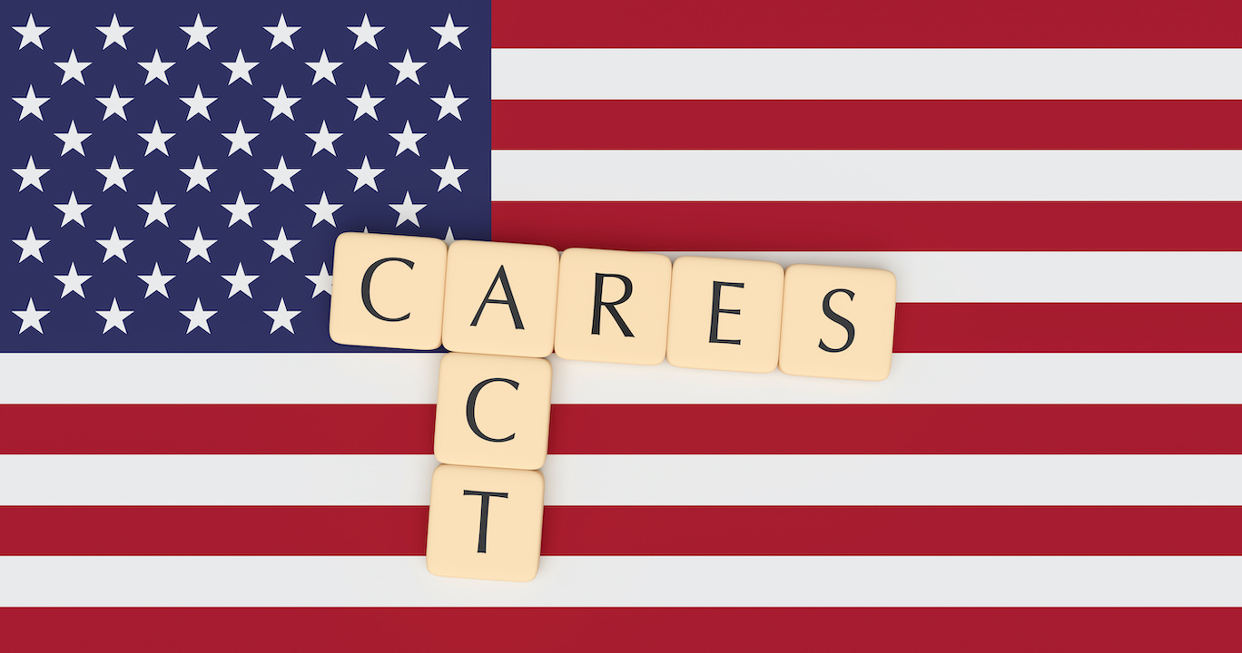 Coronavirus Aid, Relief, And Economic Security Act: Letter Tiles CARES Act On US Flag, 3d illustration