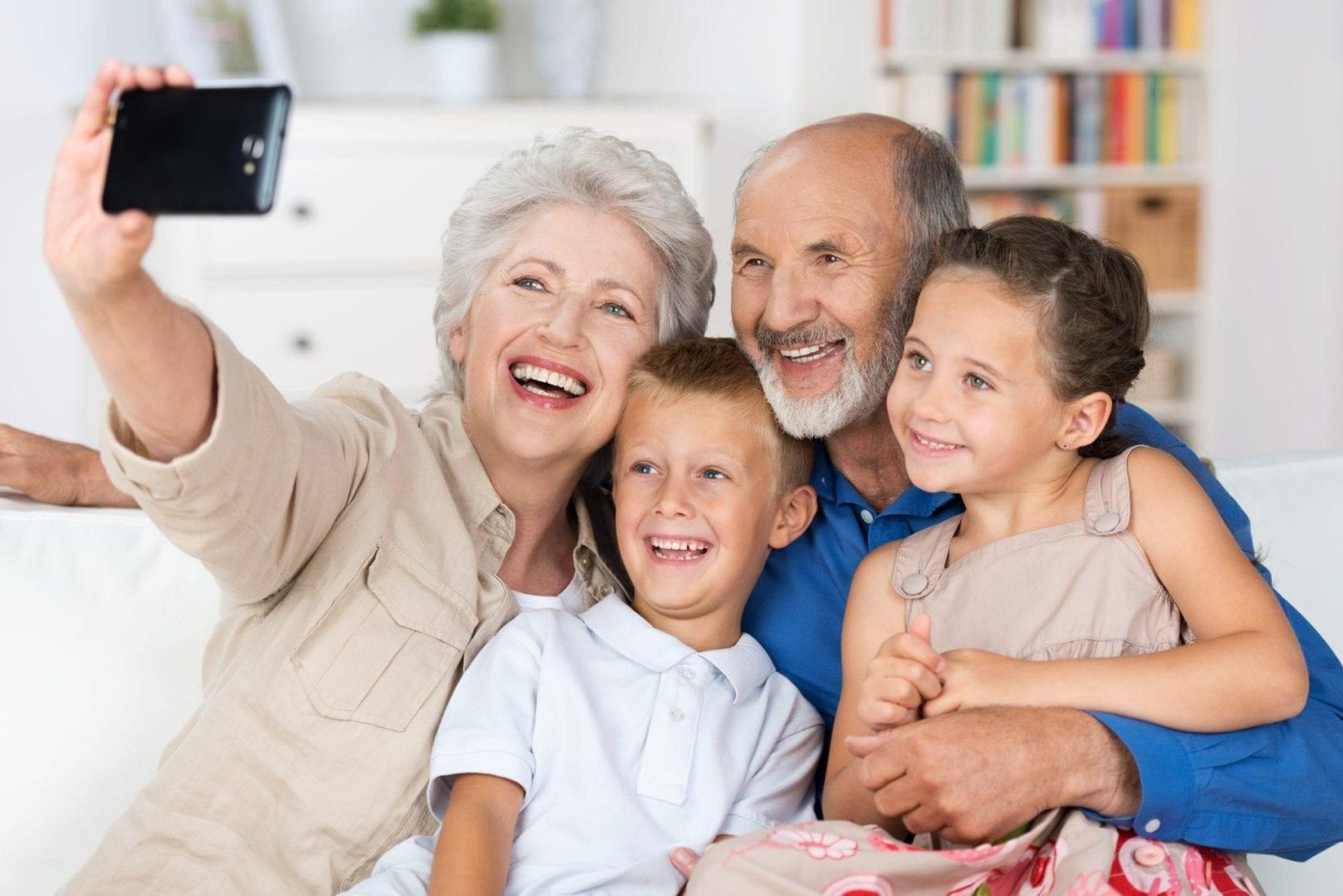 Grandparents taking a photo with grandchildren