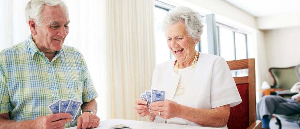 Retired couple playing cards